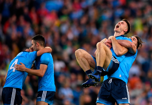 Michael Darragh Macauley, left, celebrates with Dublin team-mate David Byrne following their All-Ireland SFC final replay win over Kerry
