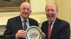 GOOD SPIRITS: Charlie Flanagan presents the plaque to Shane Ross to mark the re-opening of Stepaside Garda station