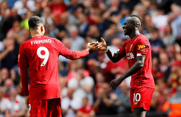 Liverpool's Sadio Mane celebrates scoring their second goal against Newcastle with team-mate Roberto Firmino. Photo: Reuters/Phil Noble