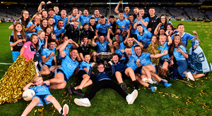 Tangled up in blue: Dublin players and some of their young fans get the party started with the Sam Maguire on the Croke Park pitch. Photo: Sam Barnes/Sportsfile