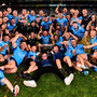 Dublin players and family get the party started with the Sam Maguire on the Croke Park pitch. Photo: Sam Barnes/Sportsfile