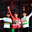 (l-r) second-placed Team Movistar rider Spain's Alejandro Valverde, winner Team Jumbo rider Slovenia's Primoz Roglic and third-placed Team UAE Emirates rider Slovenia's Tadej Pogacar, celebrate on the podium after the 21st and and last stage of the 2019 La Vuelta cycling Tour of Spain, a 106,6 km race from Fuenlabrada to Madrid. Photo: Oscar Del Pozo /Getty Images