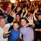 High fives: Dublin fans celebrating at the Boar's Head on Capel Street, Dublin. Photo: Steve Humphreys