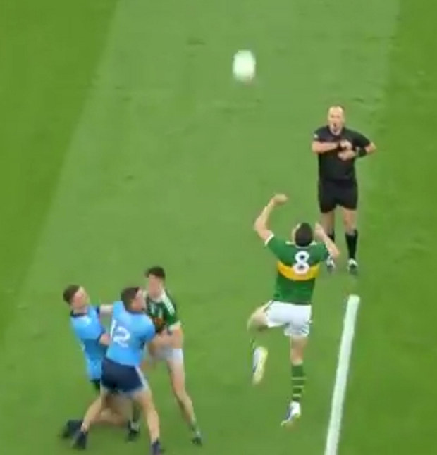 2: With Jack Barry occupying both Brian Howard and Brian Fenton, David Moran is afforded the chance to jump uncontested for the throw-in. However, rather than catch or knock the ball back to his own side, he opts to punch it forward