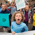 Schoolchildren marching through Cambridge city centre in England during a climate change protest. Photo: Stefan Rousseau/PA Wire