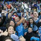 Carla Rowe lifts the cup among Dublin fans at Croke Park. Photo: Kyran O'Brien