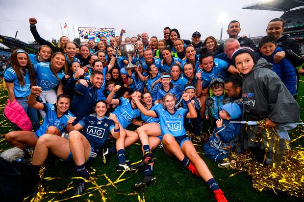 Dublin players, management and family celebrate with the Brendan Martin Cup. Photo: Stephen McCarthy/Sportsfile