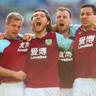 Jeff Hendrick celebrates with team-mates after scoring Burnley's equaliser. Photo: Dan Istitene/Getty Images