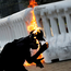 An anti-government protester catches fire after throwing a Molotov cocktail during a protest in Hong Kong. Photo: Reuters
