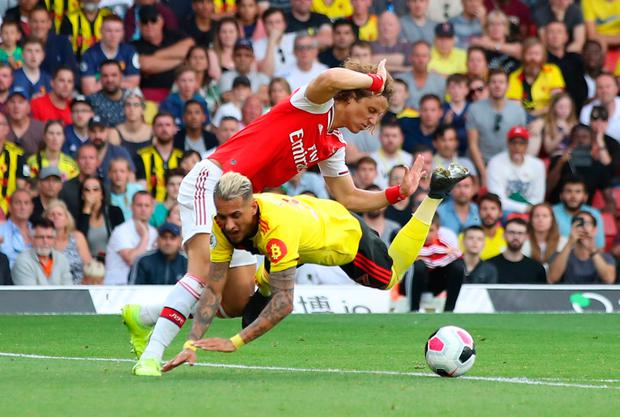 Watford's Roberto Pereyra is fouled by David Luiz for a penalty. Photo: Marc Atkins/Getty Images
