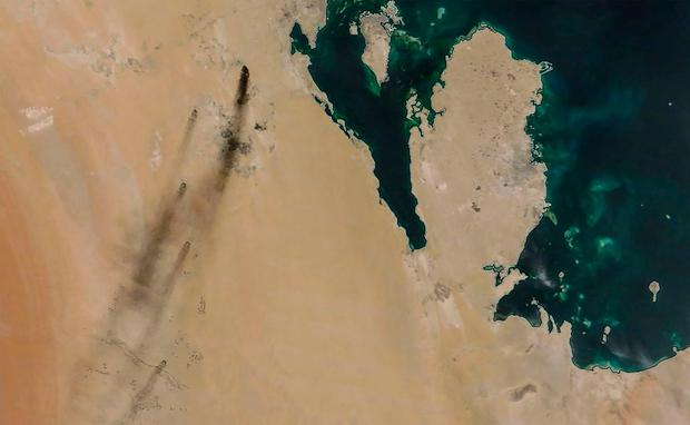 A satellite image provided by NASA Worldview on September 14, 2019, shows fires following drone strikes on two major oil installation owned by the state giant Aramco, in eastern Saudi Arabia. Photo: AFP PHOTO / NASA Worldview
