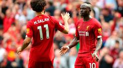 Liverpool's Sadio Mane (right) celebrates scoring his side's second goal of the game with team-mate Mohamed Salah during the Premier League match at Anfield, Liverpool. Photo: Nigel French/PA Wire.