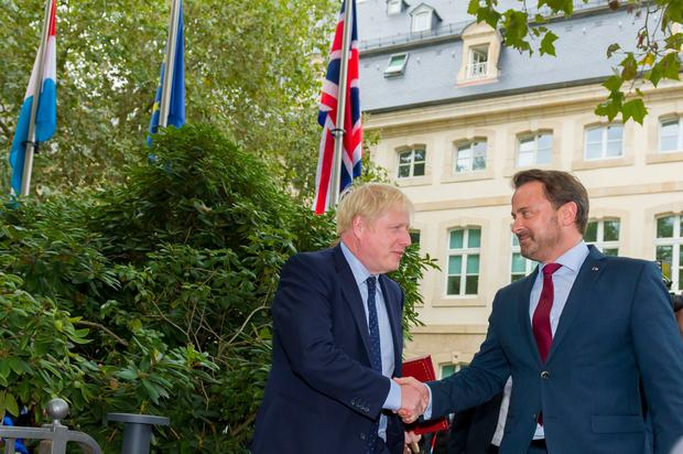 Prime Minister Boris Johnson and Prime Minister Xavier Bettel shake hands before their meeting in Luxembourg Photo credit: Emmanuel Claude/Luxembourg Government/PA Wire