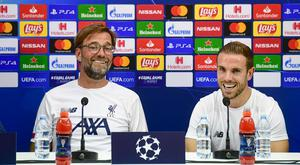 Liverpool coach Jurgen Klopp, left, and midfielder Jordan Henderson meet the media ahead of Tuesday's Champions League Group E soccer match between Napoli and Liverpool, at the San Paolo stadium in Naples, Italy. Photo: Ciro Fusco/ANSA via AP