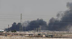 Aftermath: Smoke is seen at the facility in the city of Abqaiq, Saudi Arabia, after it was attacked. Photo: Reuters
