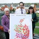 Cash at hand: Junior Minister for Health Promotion Catherine Byrne, Health Minister Simon Harris and Sláintecare executive director Laura Magahy with a map of the new funding allocations. Photo: Maxwells