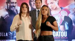 Christina Linardatou and Katie Taylor pose as promoter Eddie Hearn looks on during the press conference Action Images via Reuters/Carl Recine