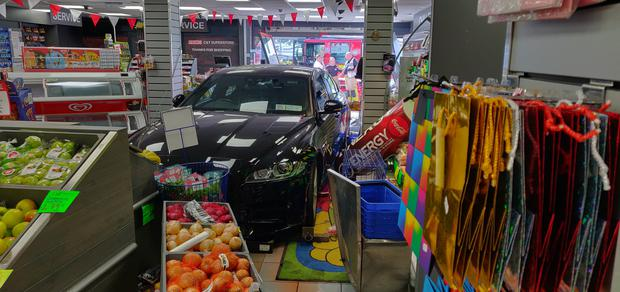 The car drove through the shop front at around 1.30pm this afternoon Photo: Carpe Diem Wholesale