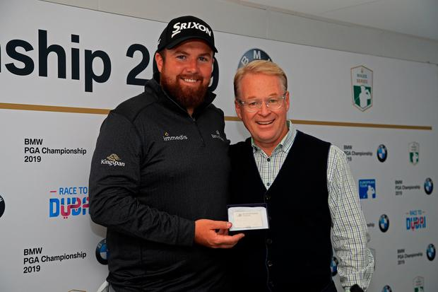 Shane Lowry is presented with Honorary Life Membership of The European Tour by Keith Pelley, Chief Executive of The European Tour at the Wentworth Club