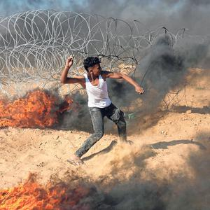 A protester at the Israeli border. Photo: Anadolu Agency