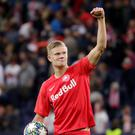 RB Salzburg's Erling Braut Haaland celebrates winning the match and scoring a hat-trick with the match ball. REUTERS/Leonhard Foeger