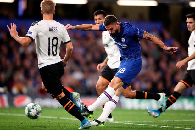 Chelsea's Olivier Giroud shoots during the UEFA Champions League Group H at Stamford Bridge, London. Photo: Nick Potts/PA Wire