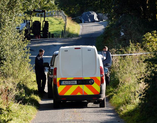 Gardai at the scene where a man aged in                       his 60s, was shot dead in Aghamore, Ballyhaunis.                       Photo: Ray Ryan