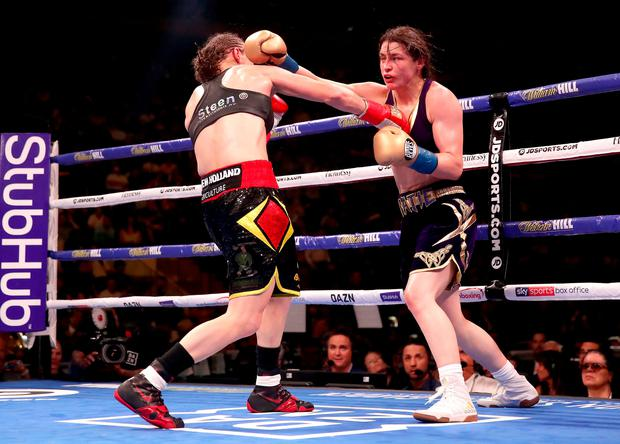 Katie Taylor (right) in action against Delfine Persoon in the IBF, WBC, WBO, WBA, Ring Magazine Women's Lightweight World Championships fight at Madison Square Garden, New York. Nick Potts/PA Wire.