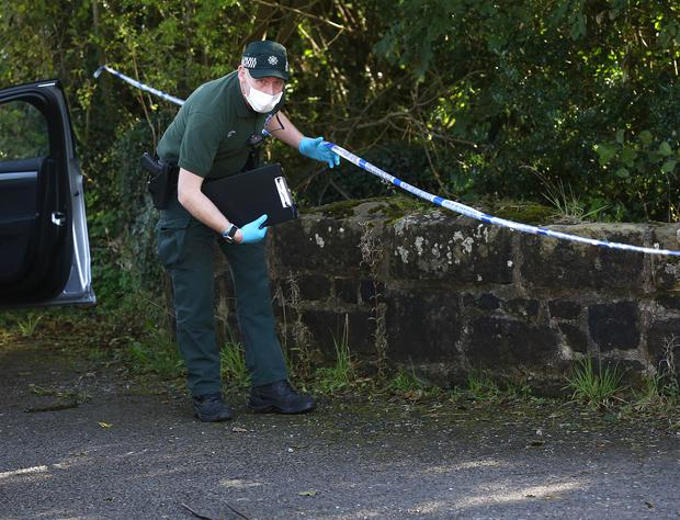 A member of the PSNI near a laneway leading to the home of Kevin Lunney Picture credit: Damien Eagers / INM