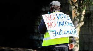 A farmer protests at the gates of Kildare town meat factory in recent weeks. Pic:Mark Condren