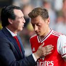 Arsenal's Mesut Ozil with manager Unai Emery after being substituted at the weekend. REUTERS/David Klein