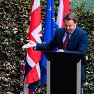 Empty podium: Luxembourg Prime Minister Xavier Bettel makes the most of Boris Johnson's no show at the press conference. Picture: Getty