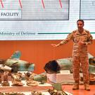 'Evidence': Saudi Colonel Turki al-Malki displays pieces of what he said were Iranian cruise missiles and drones recovered from the attack site. Photo: AFP/Getty Images