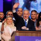 Top of the polls: Israeli Prime Minister Benjamin Netanyahu waves to supporters at his Likud party's campaign headquarters in Tel Aviv. Photo: AFP/Getty Images