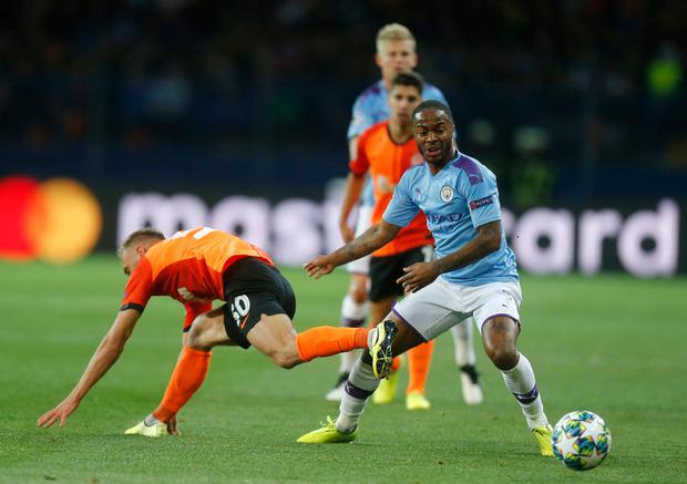 Manchester City's Raheem Sterling holds off Shakhtar's Serhiy Bolbat during their Champions League clash in Kharkiv, Ukraine PA. Photo: AP