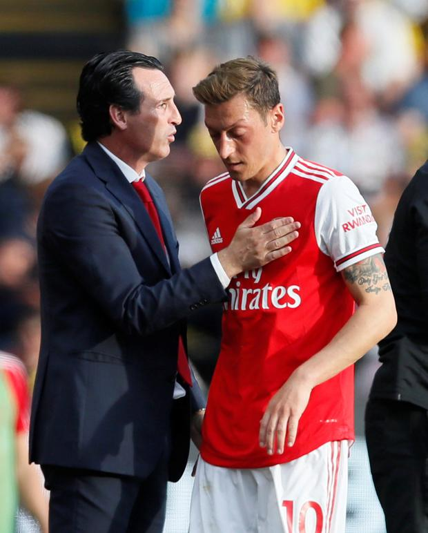 Arsenal's Mesut Ozil with manager Unai Emery. Photo: Reuters