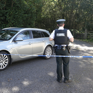 Terrifying: Members of the PSNI near a lane way leading to the home of Kevin Lunney, in Kinawley, Co Fermanagh, yesterday. Photo: Damien Eagers