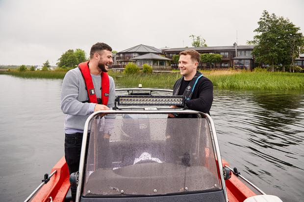 Worth a punt: Ireland rugby players Robbie Henshaw and Jack Carty on Lough Ree at Glasson, close to where they grew up. Photo: Corin Bishop