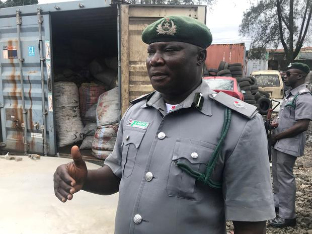 A customs official talks about the seizures of containers with sacks of confiscated pangolin scales, close to Nigeria Customs Service in Ikeja. Pictures: REUTERS/Seun Sanni