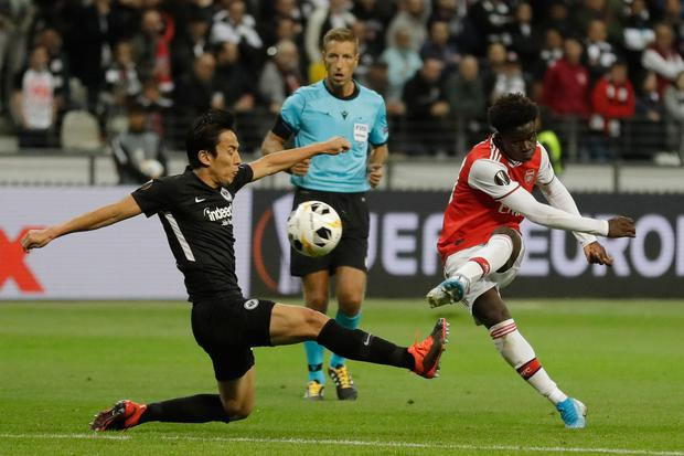 Arsenal's Bukayo Saka, right, scores his side's second goal during the Europa League Group F win over Eintracht Frankfurt at the Commerzbank Arena in Frankfurt, Germany. (AP Photo/Michael Probst)
