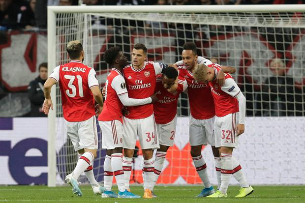 Arsenal's Joe Willock, third right, celebrates with his team-mates after scoring his side's opening goal during the Europa League Group F win in Frankfurt, Germany, Thursday, Sept. 19, 2019. (AP Photo/Michael Probst)