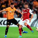 Wolves' Irish defender Matt Doherty (left) and SC Braga's Paulinho battle for the ball during the Europa League Group K match at Molineux. Photo: Mike Egerton/PA Wire
