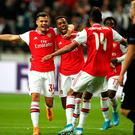 Joe Willock of Arsenal celebrates with his teammates after he scores the first goal. Photo: Christian Kaspar-Bartke/Bongarts/Getty Images