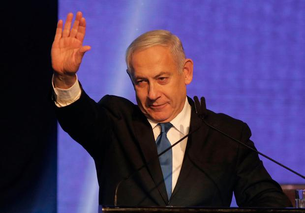 Israeli Prime Minister Benjamin Netanyahu waves as he addresses supporters at his Likud party's electoral campaign headquarters early on September 18, 2019. Photo: Menahem KAHANA / AFP