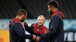 England's head coach Eddie Jones interacts with Ellis Genge and Courtney Lawes during training in Sapporo, Japan, September 20, 2019. REUTERS/Peter Cziborra