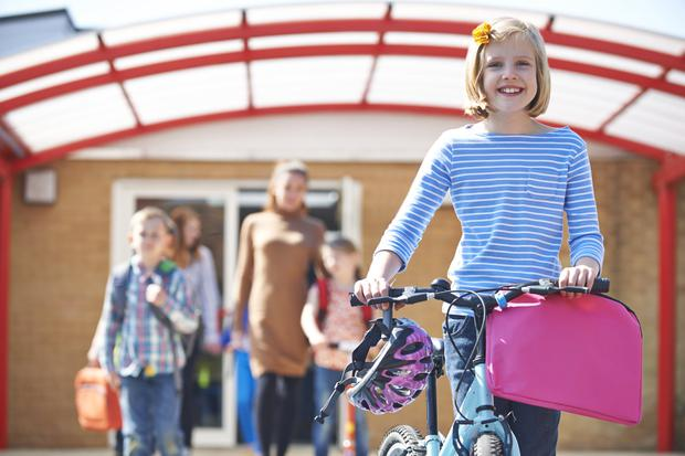 School girl on a bike. Stock image