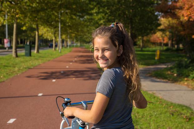 Child rides a bike on a bike path. Stock image