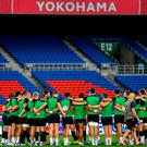 The Ireland team huddle during the Ireland captain's run ahead of their opening Pool A game against Scotland at the International Stadium in Yokohama, Japan. Photo by Ramsey Cardy/Sportsfile