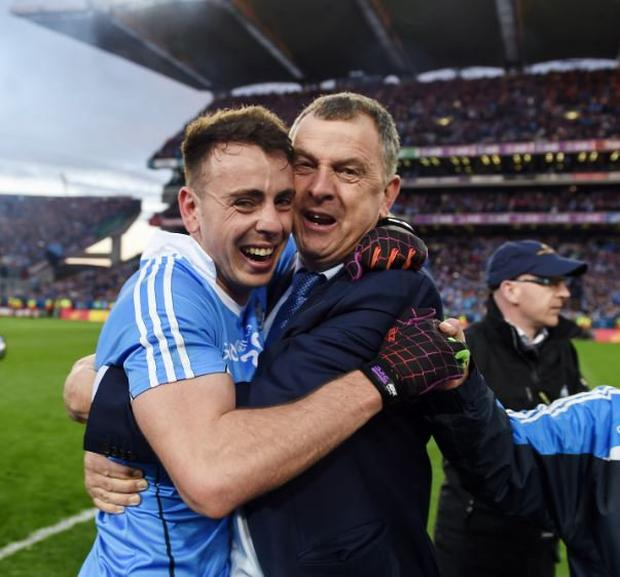1 October 2016; Cormac Costello of Dublin celebrates with his dad, Dublin County Board CEO John, after the GAA Football All-Ireland Senior Championship Final Replay match between Dublin and Mayo at Croke Park in Dublin. Photo by Ray McManus/Sportsfile