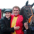 AP McCoy hugs Pat Smullen in the parade ring after Quizzical wins the Pat Smullen Champions Race For Cancer Trials Ireland during day two of the Longines Irish Champions Weekend at the Curragh. Niall Carson/PA Wire